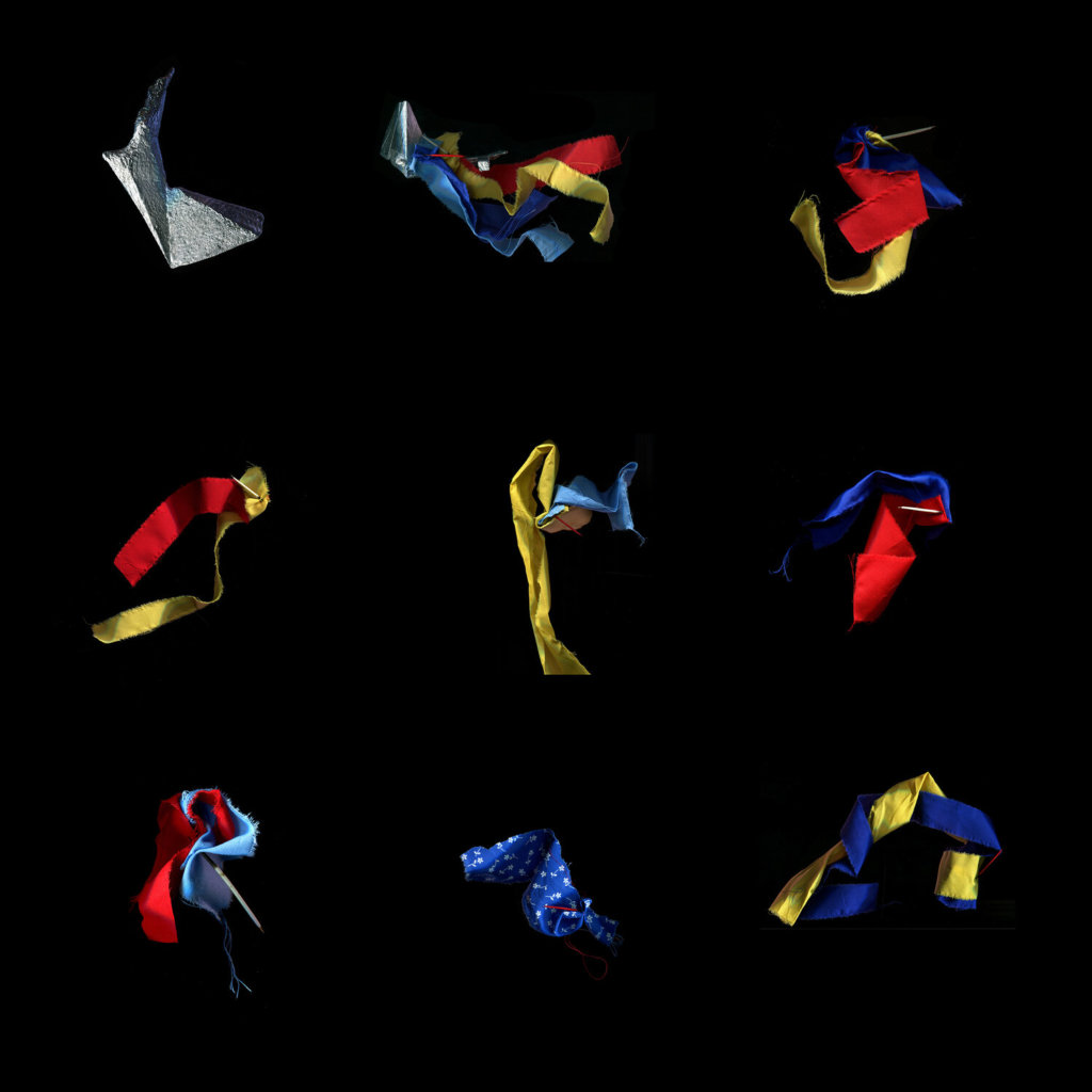 This image contains colourful strips of fabric (yellow, red, light blue, dark blue), each bundle attached together with a porcupine quill. There are eight of these bundles plus one other item spaced out in a three-by-three grid on a black background. The other item appears to be a digital rendering of some topographical section. A bit of this item also appears in one of the fabric bundles.