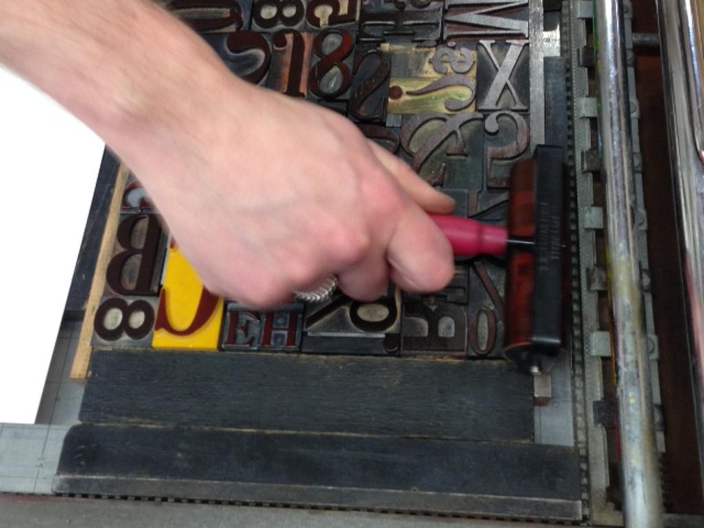 Inking a letterpress forme.